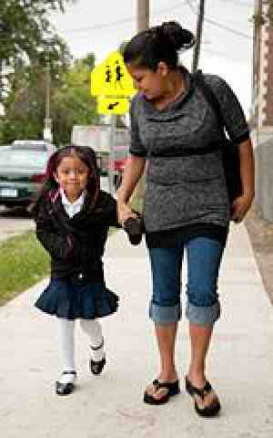Mom walks daughter to school